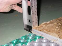Basement Flooring Tiles With A Built In Vapor Barrier Strikingly Beautiful Basement Floor Moisture Barrier Flooring