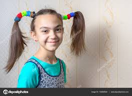 11 year old girl portrait of a smiling 11 year old girl with funny tails in the style