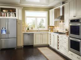 kitchen design a small kitchen with a refrigerator and cabinets