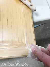 how paint kitchen cabinets the latina next door the time add wood filler hardware holes currently your cabinets let dry sand area and remove sawdust painted kitchen