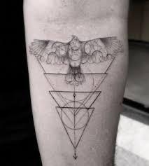 hawk and triangles tattoo by dr woo tattoomagz