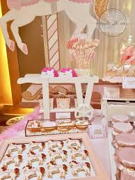 rose gold candy table celebrate with cake carousel themed dessert table in gold cream