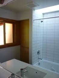 a modern take on a mid century modern master bathroom wood