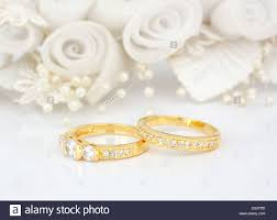 wedding flowers background gold wedding rings on flowers background stock photo royalty free