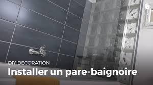 Paroi Baignoire Castorama by Installer Un Pare Baignoire Bricolage Youtube