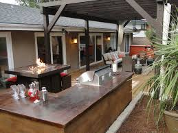 appealing decor on large patio with brown countertop under black