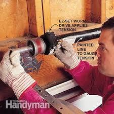 Garage Door Torsion Spring Winding Bars by How To Install A Garage Door Family Handyman