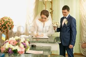 wedding signing portrait of beautiful signing wedding license at