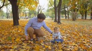 cute baby boy autumn leaves wallpapers cute baby boy sitting on ground with father and picking yellow