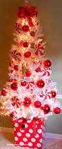 white christmas tree with pink and silver decorations ne wall