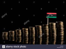 Lybian Flag Libyan Flag With Lot Of Coins Isolated On Black Background Stock