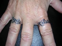 traditional wedding ring finger tattoo design real photo