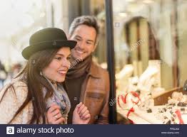 looking with grey hair trendy couple is looking at engagement rings a grey hair man with
