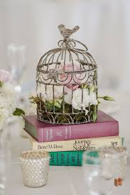 Decorative Bird Cages For Centerpieces by Flowers In Birdcage On Books Wedding Center Piece For Vinatge