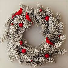 Decorating Pine Cones With Glitter Creative Christmas Wreaths Pinecone Wreaths And Cardinals