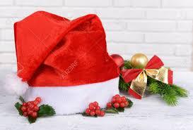 mistletoe hat leaves of mistletoe with christmas hat on table on brick wall