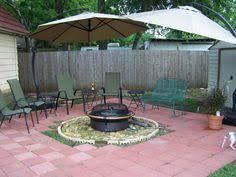 a beautifully garden area design for garden with blue table