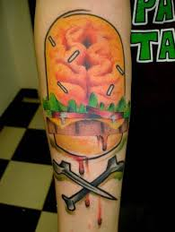 a brain burger is the skull in this skull and crossbone tattoo by