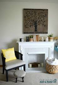 a simple redo of a secondhand electric fireplace drab to fab
