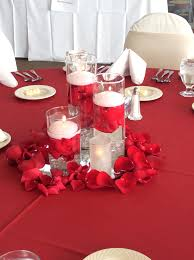 Rose Petal Table Cloth Triple Cylinder Vases With Floating Candles And Red Rose Petals
