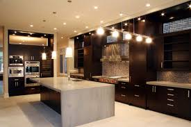 dark kitchen cabinets with countertops under rectangular flush