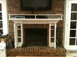 creative flat panel tv above appear living room with fireplace tv