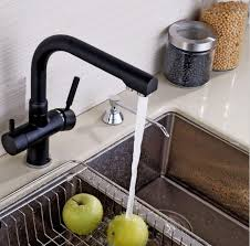 black faucet with stainless steel sink using an elegant black kitchen faucet wearefound home design