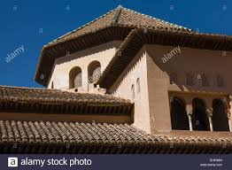 terracotta roof tiles and intricate window blinds of the alhambra