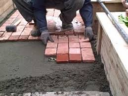 Paver Patios Installed In The Installing Cobblestone Patio Pavers In The Front Yard Urban Edible