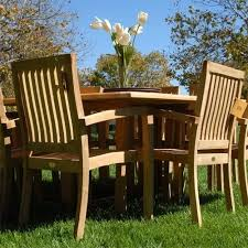 bayview patio grade a teak 9 piece patio dining set with double