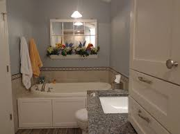 traditional full bathroom with high ceiling u0026 flat panel cabinets