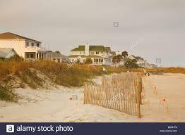 edisto beach houses and fence south carolina coast stock photo
