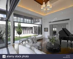 piano in living room grand piano in living room of private residence singapore stock