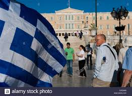 athenians walking in front of the greek parliament syntagma sq