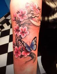 lovely cherry blossom with butterfly on forearm