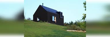 This Small House by This Small Black House Sits On A Slope In The Croatian Countryside