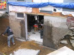 slab vs crawl space foundation cutting a door in a concrete foundation