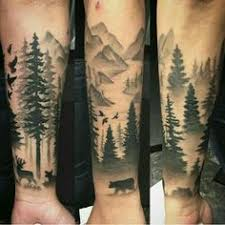 your skin gets decorated by tattooing forest tree fire full sleeve