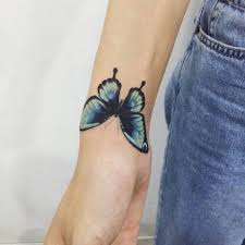 blue butterfly on the right wrist artist doy