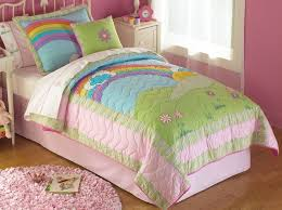 quilt in bright pink rainbow colors for twin and full queen for