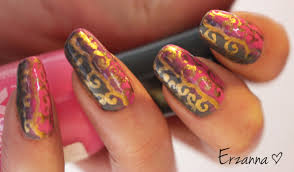 hand painted design using a golden nailpolish on top of grey and