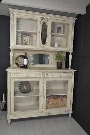 french shabby chic kitchen dresser with chicken wire doors artwork