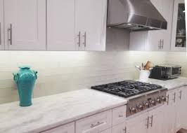 cost of refacing cabinets vs replacing lovely glass tile backsplash cost gold of refacing cabinets vs