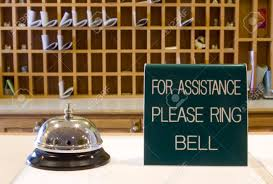motel check in desk with bell and sign stock photo picture and