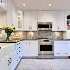 backsplashes for white kitchen cabinets white cabinets with the multi backsplash counters and gray