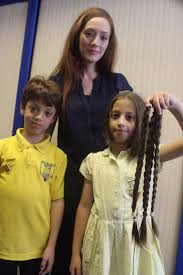 schoolgirl alysa has hair cut in assembly to donate plaits to
