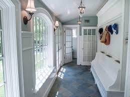 traditional mud room with high ceiling slate tile floors in