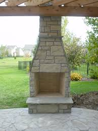 natural stone wood burning fireplace incorporated into cedar