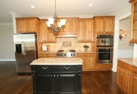 kitchen island colors with wood cabinets oak cabinets and black painted island kitchens