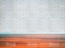 Modern Brick Wall by Interior Of Modern Empty Brick Wall With Wooden Floor Stock Photo